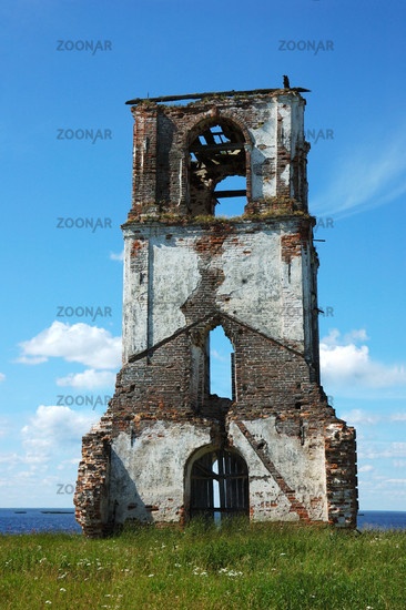 Old destroyed belfry in northern russian village Nokola