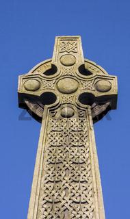 Celtic cross against blue sky