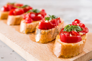 Closeup of Italian bruschetta with tomato, basil and garlic
