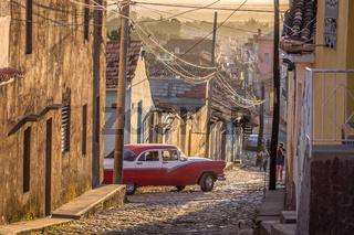 Cuban street with oldtimer in Trinidad