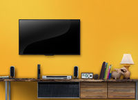 Led tv wooden table with yellow wall in livingroom