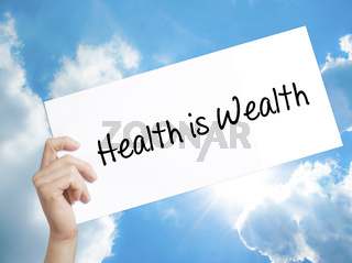 Health is Wealth Sign on white paper. Man Hand Holding Paper with text. Isolated on sky background