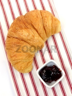 A croissant served with jam