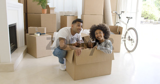 Happy young couple moving house together