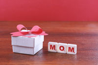 Mothers day background with box and red ribbon