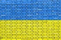 flag of Ukraine painted on brick wall