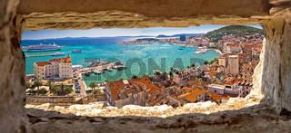 Split waterfront aerial panoramic view through stone window