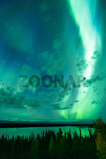 Lake Reflects Aurora Borealis Emerging Through Clouds Remote Alaska