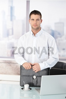 Casual office worker standing in office