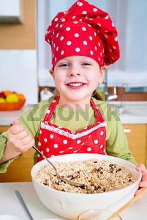 Girl preparing granola in the kitchen at home