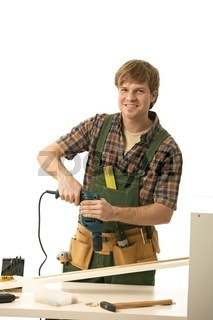 Happy young man tinkering