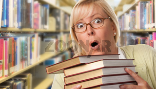 Beautiful Expressive Student or Teacher with Books in Library.