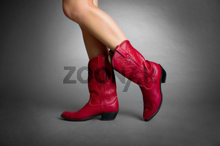 Female Legs Wearing Red Boots