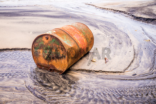 Old rusty barrel oil on beach