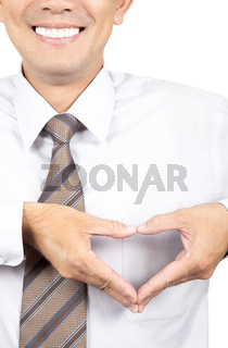 smiling businessman with heart made from hands