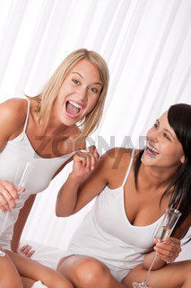 Two girlfriens having fun together