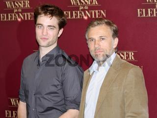 Robert Pattinson und Christoph Waltz