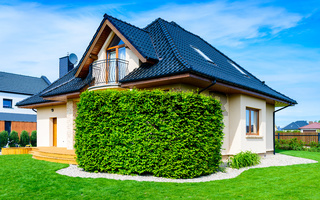 Single family house against blue sky