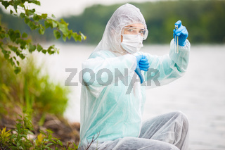 Biologist with test tube in mask
