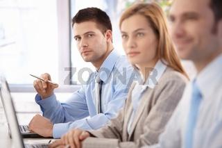 Confident businessman at business training