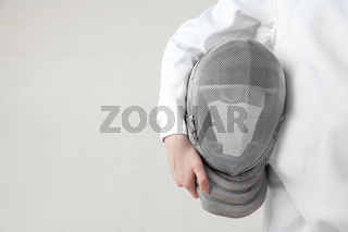 Female fencer hold the fencer mask isolated on white background