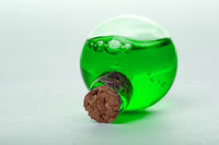 green liquid in old style vial