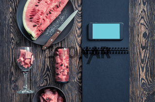 Mockup of the smartphone next to watermelon slices. Clipping path