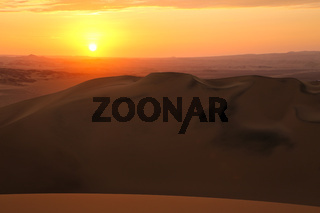 Sand dunes near Huacachina at sunset, Ica region, Peru.