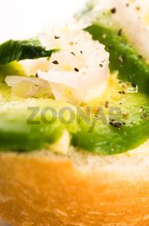 Sandwich with avocado on a wooden board