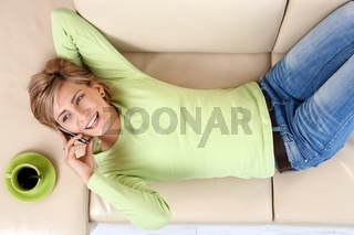 Laughing woman talking on cell