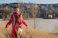 walking woman on winter lake and mountain background