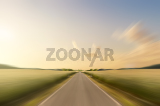 empty, straight road in rural landscape