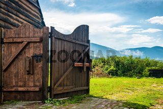 Rural wooden gate and green lawn