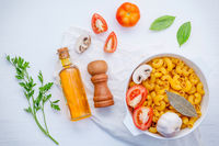 basil ,tomato ,garlic ,extra virgin olive oil ,parsley ,bay leaves and champignon  on white background  flat lay .
