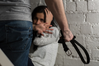 unhappy woman suffering from domestic violence