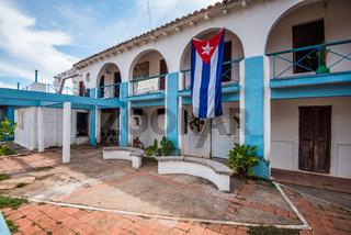 Cuban bandera or flag on colonial building
