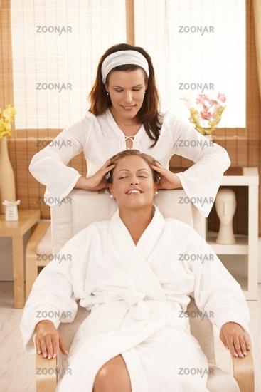 Happy woman enjoying head massage