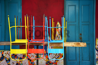 Colorful chairs on a wooden table