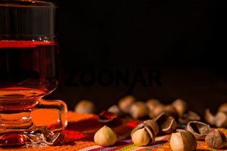 Closeup of alcoholic punch drink and hazelnuts