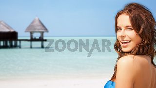 happy beautiful woman on tropical beach