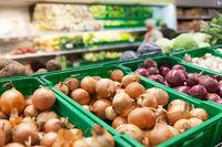 Onions on supermarket vegetable shelf