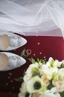 Wedding arrangement, rings, shoes, veils and bridal bouquet