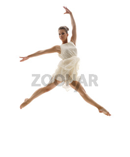 Beautiful ballerina posing in graceful leap