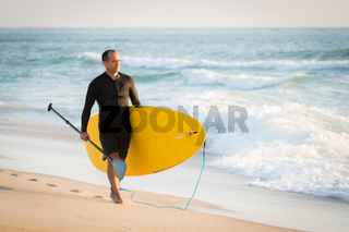 man with his paddle board