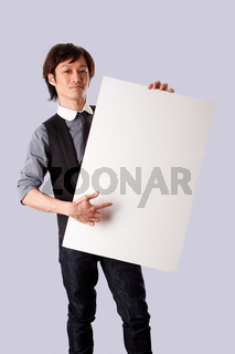 Asian business man pointing at white board