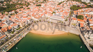 People relax on the beautiful beaches of Cascais Portugal aerial view