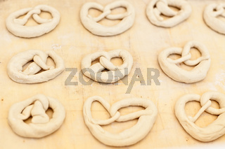 Uncooked pretzel ready to be baked