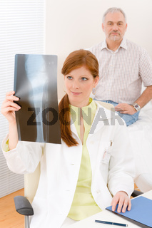 Doctor office - female physician patient x-ray