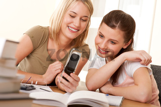 Student series - Two girls watching mobile phone