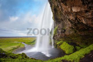Passage under waterfall Seljalandsfoss